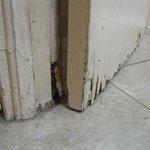 rotting water damaged batroom door
