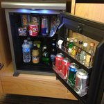The mini fridge in the room.