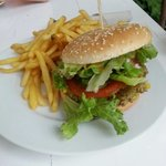 Vegetable burger and chips with raspberry relish. Vegan.