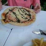 Tomato and vegan style mozzerella with basil pizza. Vegan.