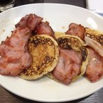 American style pancakes with bacon and maple syrup. Delicious!