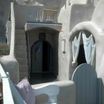 View of Kalypso room's door, private porch (above door), and entrance to private jacuzzi