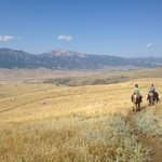 Yellostone's Electric Peak and horseback riders with Hells'A Roaring