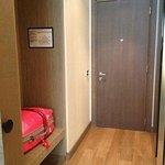 Towards the main door.  Luggage rack