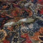Torn bedspread