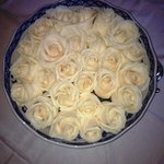 Bowl of fresh white roses in the drawing room