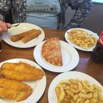 "Our family dinner - deep-fried sausage, fish & (2 plates of) chips (that's ""french fries"" for us"