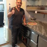 Guiseppe is a master pizza maker!