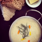 Cauliflower & fennel cream soup with marigold petals