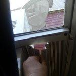 the hole in window to unlock the front door