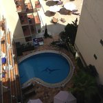 view from roof terrace to ground floor pool and sun bathing area.