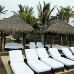 Many beach chairs and relaxation beds.
