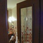 big mirror on bathroom door increases the perceived room size