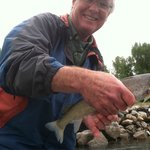 fish in hand and big smile on his face!