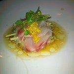 Sea Bass Citrus - sea bass sashimi topped with yuzu tobiko, over an apple slaw