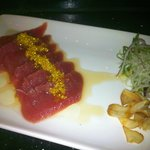 Truffle Tuna - topped with yuzu lemon sauce and truffle oil, yuzu infused golden tobiko