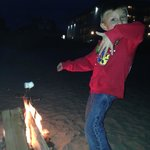 my grandson at our fire