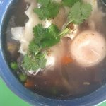Thai rice soup with veggies and an egg. Quality food in Hua Hin, no MSG