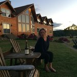 My fiancee Rachel enjoying wine and a beautiful lakeside sunset at the Lodge