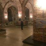 Area of the crypt in front of the cafe with hanging art.