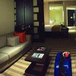 Pano-photo from end of living room area of the suite towards bed, bath and door