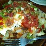 Veggie skillet with over medium eggs and fresh salsa