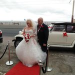 father and bride on the red carpet outside hotel