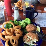 Crab cakes, onion rings & broccoli. Fried shrimp in background