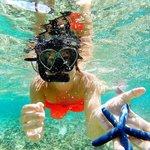 Snorkeling infornt of the resort