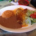 Carnitas enchiladas with red mole