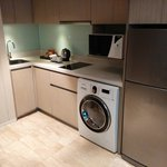 Small Kitchen with electric stove, microwave, washer+dryer and fridge