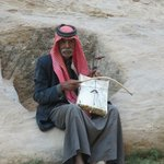 an old Bedouin playing his Rababa