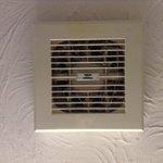 Bathroom fan full of dust & cobwebs.