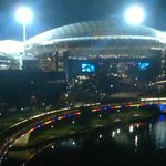 View of footy fans streaming back over footbridge after game