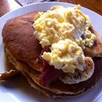 Fluffy pancakes with scrambled egg and bacon
