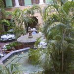 an open courtyard serves the guests in air cooled by the lush greenery.