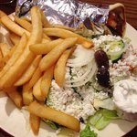 Souvlaki, fresh fries and greek salad