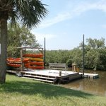 Kayaks and rear dock on waterway
