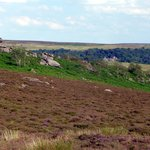 Longshaw Lodge seen from the hills opposite - with Mother Cap stone outcrop in the foreground.