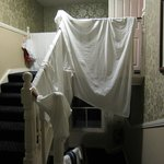 laundry hanging on banisters