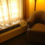 chair and A/C unit in room