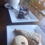 Latte, flourless chocolate cake, blackberry scone, macaron