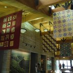 Quilts hanging from the ceiling