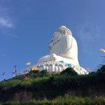Buddha sits