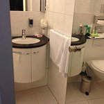 Sink inside bathroom.  They used re-cycled toilet tissue; brownish.