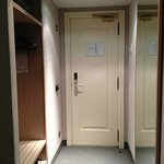 Main door.  Room safe and luggage rack