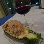 Fried rice, vegetables and pork in pineapple