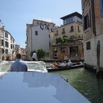 Arriving Venice by taxi boat