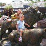 Climb on the lions at the entrance!  It is a tradition going back to the zoo's first visitors.