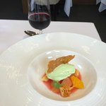 Plums in soup with Basil ice cream and honeycomb